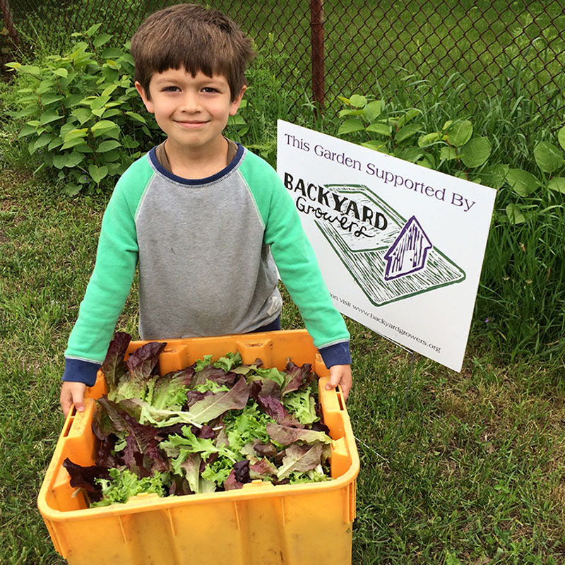 Backyard Growers Community Involvement - Salad Days Student with bin