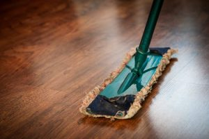 Dark Wood Floor being mopped