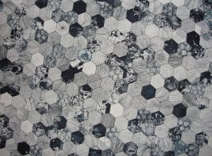 Close Up Image of Intricate Tile Design of black, white and grey hexagon tiles