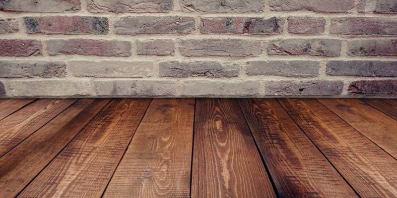 Close up of Wood Floor and Brick Wall