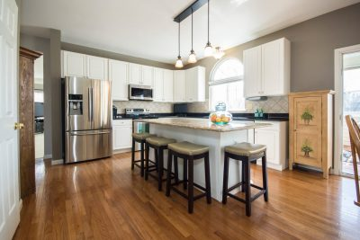 Overview Shot of Kitchen with Stainless Steel Appliances and Wood Floors
