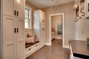 Beautiful Mudroom in New England Home with Cabinets, Benches, Storage, Pillows and Accessories