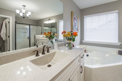 Spa Bathroom with Flowers and Granite Countertops